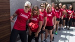 Members of Canada's Women's Rugby Sevens team led by captain Jen Kish, left, pose for a photo before an announcement by Canadian Olympic Committee (COC) and Rugby Canada in Toronto on Tuesday, July 26, 2016, to introduce the players to represent Team Canada at this year's Rio Olympics (THE CANADIAN PRESS / Chris Young)