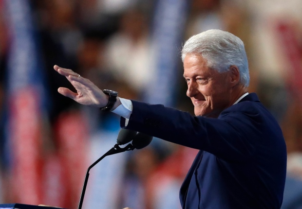 Former President Bill Clinton waves as he takes to the podium during the second day of the Democratic National Convention in Philadelphia , Tuesday, July 26, 2016. (AP Photo/Paul Sancya)