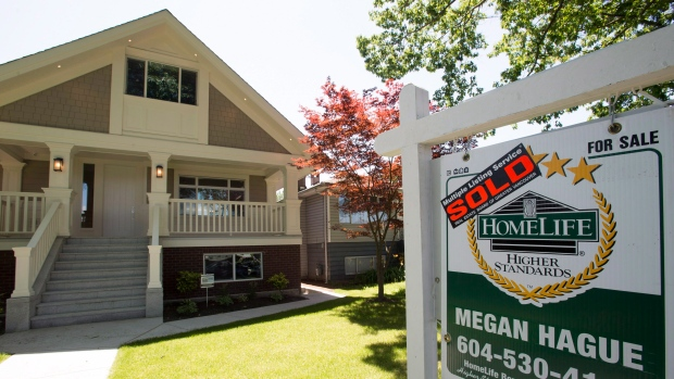 A sold sign is pictured outside a home in Vancouver, B.C., Tuesday, June, 28, 2016. THE CANADIAN PRESS/Jonathan Hayward