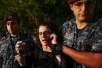 Police officers detain Armenian-Canadian actress Arsinee Khanjian during a rally near the police station which is being hold by an armed group in Yerevan, Armenia, Wednesday, July 27, 2016. (Vahan Stepanyan/PAN Photo via AP)