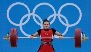 Christine Girard of Canada competes during the women's 63-kg, group A, weightlifting competition at the 2012 Summer Olympics, Tuesday, July 31, 2012, in London. Girard won the bronze medal. (AP Photo/Hassan Ammar)