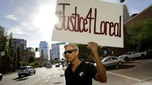 Chris Fleischman protests outside Maricopa County Attorney Bill Montgomery's office in Phoenix about the death of Loreal Tsingine on Monday, July 25, 2016. (AP / Matt York)