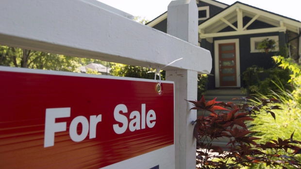 A sold sign is pictured outside a home in Vancouver on June, 28, 2016. (Jonathan Hayward / THE CANADIAN PRESS)