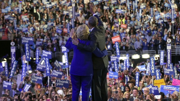 President Barack Obama, right, and Democratic presidential candidate Hillary Clinton, left, wave to the crowd following Obama's speech at the Democratic National Convention in Philadelphia on Wednesday, July 27, 2016. (AP / Susan Walsh)