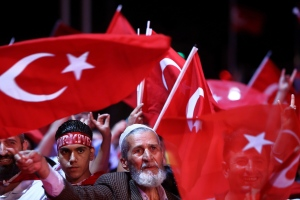 People wave Turkish flags as they take part in an anti-coup rally at Taksim square in Istanbul, Tuesday, July 26, 2016. (AP Photo/Petros Karadjias)