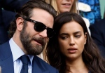 In this July 10, 2016, file photo, actor Bradley Cooper, left, speaks with his girlfriend model Irina Shayk on the fourteenth day of the Wimbledon Tennis Championships in London. (AP Photo/Kirsty Wigglesworth, File)