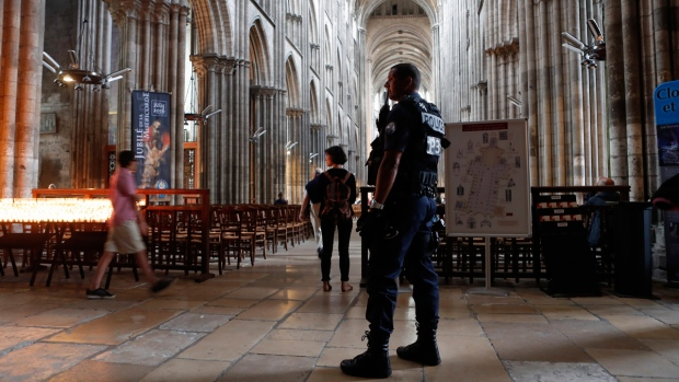 A police officer stands guard in the Cathedral Notre Dame in Rouen, Normandy, France, on July 27, 2016. (Francois Mori / AP)