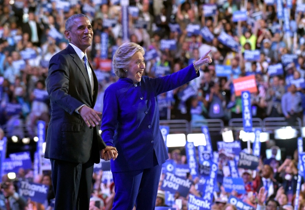 President Barack Obama stands with Democratic presidential candidate Hillary Clinton following Obama's speech at the Democratic National Convention from the Wells Fargo Center in Philadelphia, Wednesday, July 27, 2016. (AP Photo/Susan Walsh)