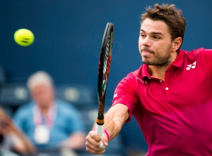 Stan Wawrinka of Switzerland returns the ball against Jack Sock of the United States during men's third round Rogers Cup tennis action in Toronto on Thursday, July 28, 2016. (Nathan Denette / THE CANADIAN PRESS)