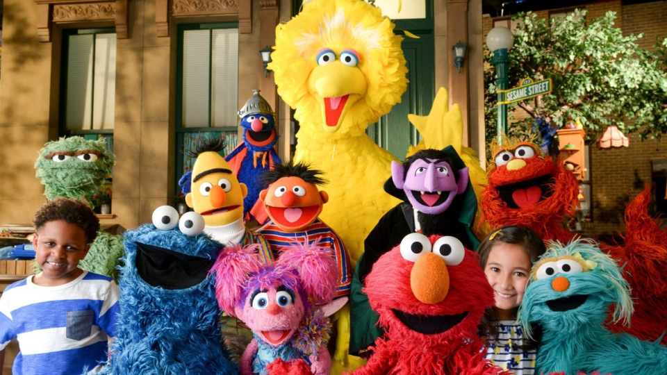 """This image released by the Sesame Workshop shows the cast of """"Sesame Street."""" (Zach Hyman/Sesame Workshop via AP)"""