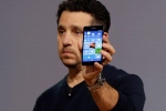 Microsoft vice president for Surface Computing Panos Panay shows a new Lumia 950 phone during a presentation, in New York, Tuesday, Oct. 6, 2015. (AP / Richard Drew)