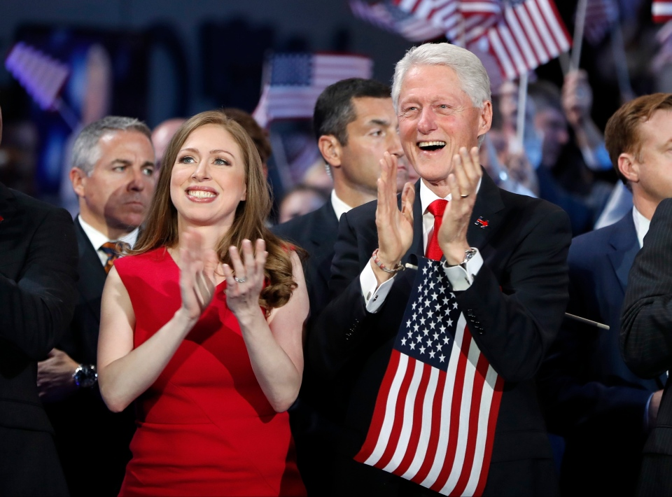 Chelsea Clinton and former President Bill Clinton applaud as Democratic presidential nominee Hillary Clinton speaks during the final day of the Democratic National Convention in Philadelphia, Thursday, July 28, 2016. (AP / Carolyn Kaster)
