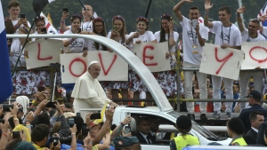People participating in the World Youth Days wave to Pope Francis in his pope-mobile in Krakow's Jordan Park, Poland on Thursday, July 28, 2016. (AP / Alik Keplicz)