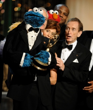 Bob McGrath, right, looks at the Cookie Monster as the accept the Lifetime Achievement Award for 'Sesame Street' at the Daytime Emmy Awards on Sunday Aug. 30, 2009, in Los Angeles. (AP / Chris Pizzello)