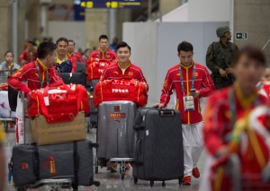 China's team arrives at Rio de Janeiro International Airport to compete at the 2016 Summer Olympics in Rio de Janeiro, Brazil, Thursday, July 28, 2016. (AP / Leo Correa)