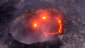 Lava from the Kilauea volcano on Hawaii's Big Island appears in a 'smiley face' in this image from a helicopter taken on July 27, 2016. (Paradise Helicopters / News from the World / YouTube)