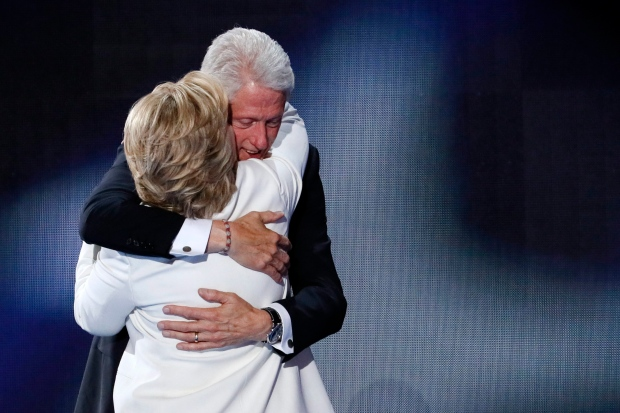 Former President Bill Clinton hugs his wife Democratic presidential nominee Hillary Clinton during the final day of the Democratic National Convention in Philadelphia , Thursday, July 28, 2016. (AP Photo/J. Scott Applewhite)