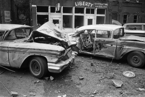 In this Sept. 15, 1963 file photo, damaged automobiles show the force generated by an explosion which tore large pieces of stone from the 16th Street Baptist Church during services in Birmingham, Ala. (AP)