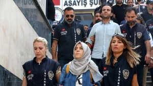 Police escort journalists to court, in Istanbul, Friday, July 29, 2016. (Ali Aksoyer/DHA via AP)