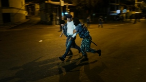 Police officers detain a supporter of the armed group who have been holding a police station in Yerevan, Armenia, Friday, July 29, 2016. (Vahan Stepanyan / PAN Photo via AP)