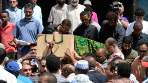 The casket of Abdirahman Abdi, who died after an altercation with Ottawa Police on Sunday, is carried out of the Ottawa Main Mosque after his funeral on Friday, July 29, 2016. (Justin Tang / THE CANADIAN PRESS)