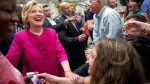 Democratic presidential candidate Hillary Clinton greets members of the audience after speaking at a rally at K'NEX, a toy company in Hatfield, Pa., Friday, July 29, 2016. (AP Photo/Andrew Harnik)