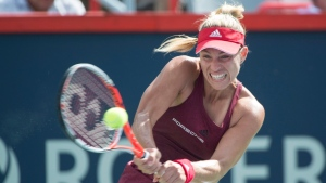 Angelique Kerber, of Germany, returns to Darya Kasatkina, of Russia, during quarter-finals at the Rogers Cup tennis tournament in Montreal on Friday, July 29, 2016. THE CANADIAN PRESS/Paul Chiasson