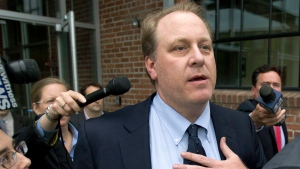In this Wednesday, May 16, 2012, file photo, former Boston Red Sox pitcher Curt Schilling, center, is followed by members of the media as he departs the Rhode Island Economic Development Corporation headquarters, in Providence, R.I. (AP / Steven Senne, File)