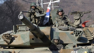 South Korean army soldiers ride a K-1 tank during the annual exercise with their U.S. counterparts in Paju, near the border with North Korea, Thursday, March 10, 2016. (Ahn Young-joon/AP Photo)