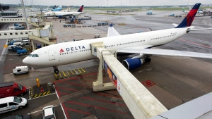In this file photo, a Delta aircraft is seen on Schiphol airport in Amsterdam, Wednesday, Aug. 7, 2013. (AP Photo / Evert Elzinga)