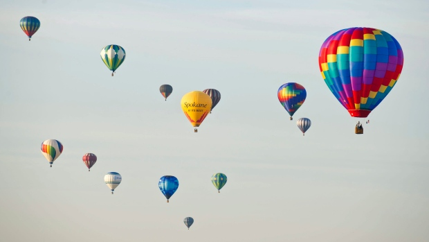 in this file photo, hot air balloons drift above Walla Walla, Wash., Saturday, Oct 17, 2015, during the 41st annual Walla Walla Balloon Stampede. (Greg Lehman / Walla Walla Union-Bulletin via AP)