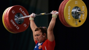 "In this Saturday, April 10, 2010 file photo, Russia's Nadezhda Evstyukhina successfully lifts a weight in the Women's 75kg category, during the European Weightlift in Minsk, Belarus. Russian state news agency Tass says the ""B'' samples of two Russian women's weightlifting medalists from the 2008 Beijing Olympics have come back positive for steroids. Marina Shainova, who won silver in the 58-kilogram class, and Nadezhda Evstyukhina, bronze medalist in the 75-kg division, were among 10 Russian medalists from Beijing who reportedly tested positive last month in IOC reanalysis of their stored samples. (Dmitry Brushko, FILE/AP Photo)"