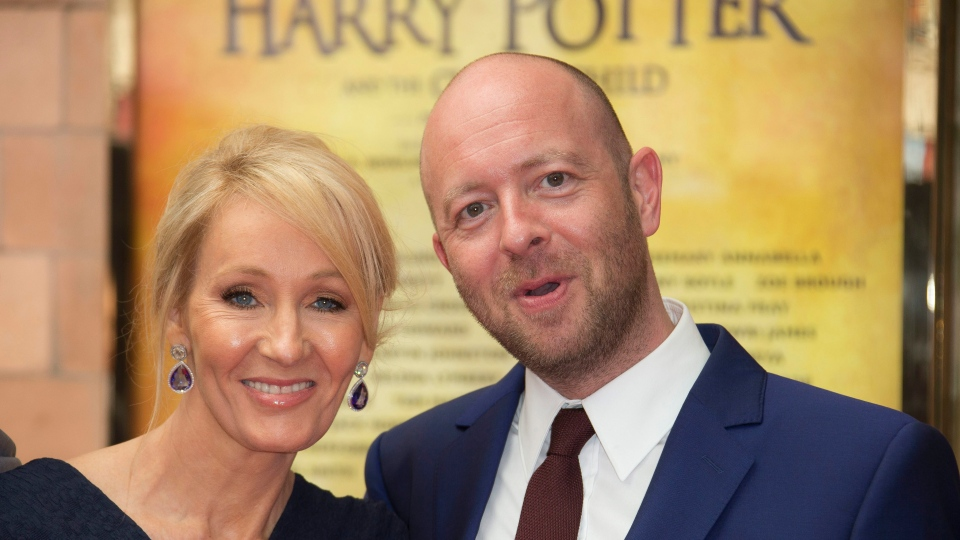 Writer J.K. Rowling, left and Director John Tiffany pose for photographers upon arrival at gala performance of Harry Potter and the Cursed Child, at the Palace Theatre in central London, Saturday, July 30, 2016. (Photo by Joel Ryan / Invision / AP)