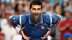 Novak Djokovic, of Serbia, celebrates after defeating Tomas Berdych, of the Czech Republic, during men's quarter-final Rogers Cup tennis action in Toronto on Friday, July 29, 2016.  (Nathan Denette/The Canadian Press)