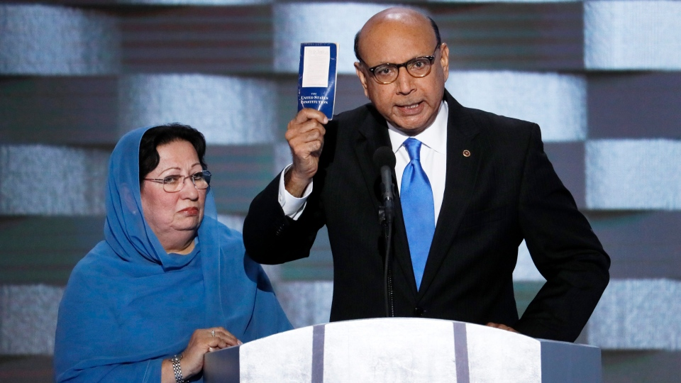 Khizr Khan, father of fallen U.S. Army Capt. Humayun S. M. Khan holds up a copy of the Constitution of the United States as his wife listens during the final day of the Democratic National Convention in Philadelphia, Thursday, July 28, 2016. (AP Photo / J. Scott Applewhite)
