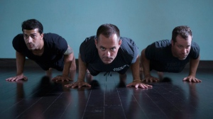 Michael DeCorte (centre) is pictured alongside alongside Salmaan Sayeed (left) and Howie Track at Toronto's Moksha Yoga studio on Saturday July 9 , 2016. THE CANADIAN PRESS/Chris Young