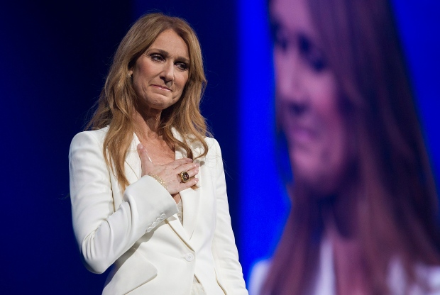 Celine Dion gestures as she performs in concert at the Bell Centre in Montreal, Sunday, July 31, 2016. (The Canadian Press/Graham Hughes)