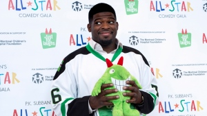 Nashville Predators defenceman P.K. Subban hams it up with a stuffed mascot during a news conference in advance of the P.K. Subban All-Star Comedy Gala in Montreal on Monday, August 1, 2016. (Paul Chiasson / THE CANADIAN PRESS)