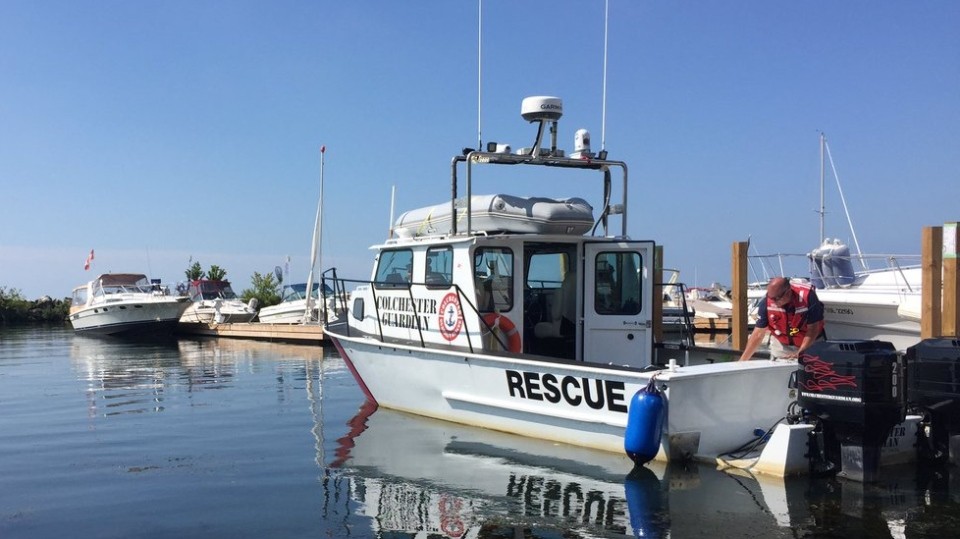 Underwater team using sonar to try to recover body of