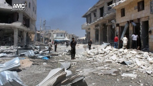 This photo provided by the Syrian anti-government activist group Aleppo Media Center (AMC), shows Syrian citizens inspecting damaged shops after airstrikes hit a market in Atareb, west of the divided city of Aleppo, Syria on Tuesday, Aug 2, 2016. The Britain-based Syrian Observatory said at least 11 people, including five children were killed when bombs were dropped in a market in Atareb. (Aleppo Media Center via THE ASSOCIATED PRESS)