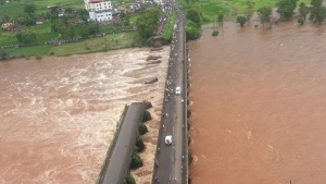 A collapsed bridge linking Mumbai and Goa in India is seen on this social media photo from Wednesday, Aug. 2, 2016. (SpokespersonNavy / Twitter)