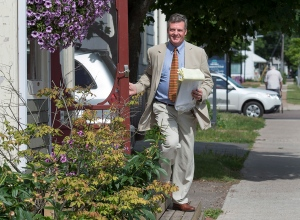 Owen Parkhouse, from Morel, P.E.I., campaigns door to door in his bid to become a senator from the Island, in Charlottetown on Tuesday, Aug. 2, 2016. (THE CANADIAN PRESS/Andrew Vaughan)