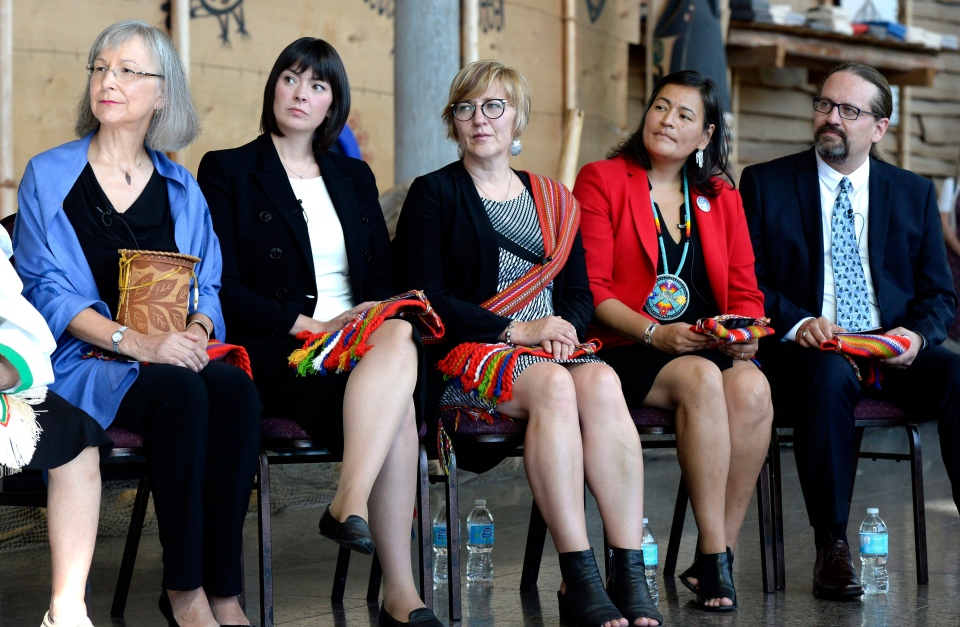 From left, Commissioners Marion Buller, Qajaq Robinson, Marilyn Poitras, Michele Audette and Brian Eyolfson listen during the announcement of the inquiry into Murdered and Missing Indigenous Women at the Museum of History in Gatineau, Que. on Wednesday, Aug. 3, 2016. (THE CANADIAN PRESS/Justin Tang)