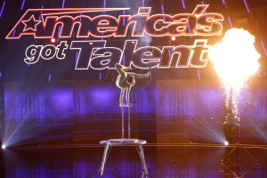 "In this image released by NBC, Sofie Dossi performs on an episode of the talent competition series, ""America's Got Talent."" NBC led in the ratings with an average of 4.7 million viewers. The week's top two shows, were NBC's two editions of ""America's Got Talent."" (Trae Patton/NBC via AP)"