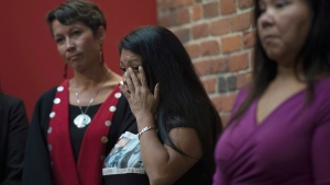 Lorelei Williams wipes a tear from her eye during a news conference on Missing and Murdered Indigenous Women and girls in Vancouver, B.C., Wednesday, August, 3, 2016. (Jonathan Hayward/The Canadian Press)