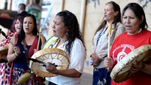 Women drum following the announcement of the inquiry into Murdered and Missing Indigenous Women at the Museum of History in Gatineau, Quebec on Wednesday, Aug. 3, 2016. (THE CANADIAN PRESS/Justin Tang)