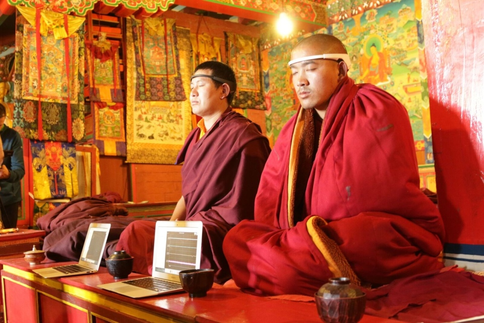 The researchers outfitted the monks with brain wave monitors and asked them to meditate. (University of Victoria)