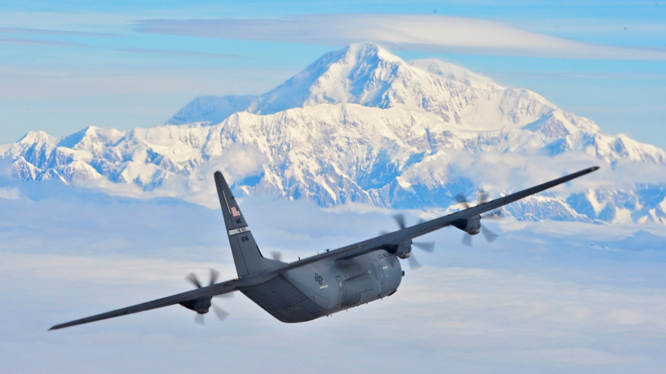 This July 19, 2016, photo provided by the U.S. Air Force shows a C-130J from the 41st Airlift Squadron flying past Denali, North America's tallest mountain located in Denali National Park, Alaska. (Senior Airman Kaylee Clark / U.S. Air Force via AP)