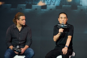 In this July 2, 2015, file photo, movie director Zhang Yimou, right, speaks next to actor Matt Damon during a news conference of their latest movie 'The Great Wall' held at a hotel in Beijing. (AP Photo/Andy Wong, File)