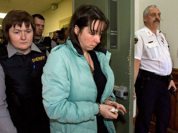 Penny Boudreau is escorted from provincial court in Bridgewater, N.S. on Friday, Jan. 30, 2009. (Andrew Vaughan / THE CANADIAN PRESS)